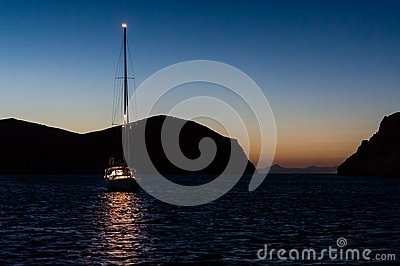 Night photo of sailing boat at anchor.