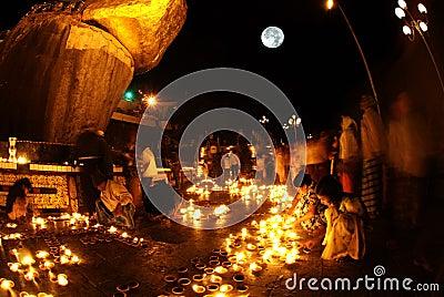 Night scene Kyaikhtiyo Pagoda in full Moon night. Editorial Stock Photo