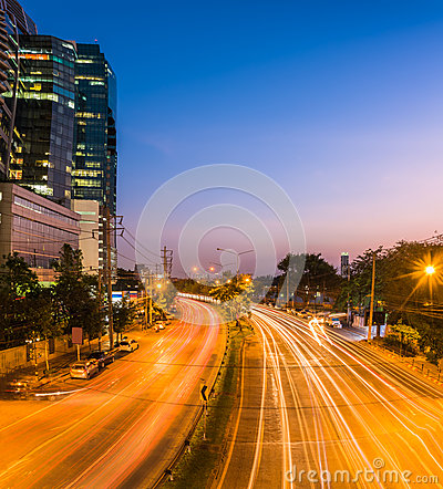 Free Night Scene Of Modern City. Building And Light Trail On Road Wit Stock Image - 67567981