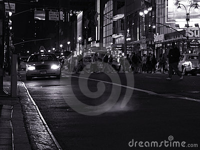 Night scene with a taxi on the street in new york