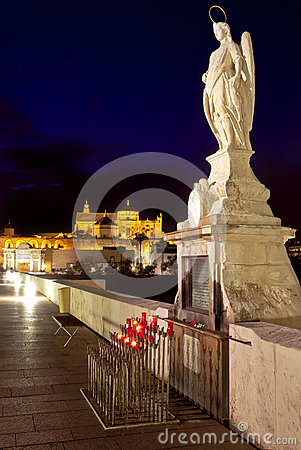 Night shot of Archangel Raphael statue on roman bridge at Cordoba, Andalusia