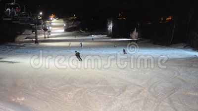 Night skiing ski resort dark night skiers. Wide stock footage
