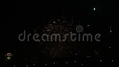 Fireworks in ight sky above town lights stock footage