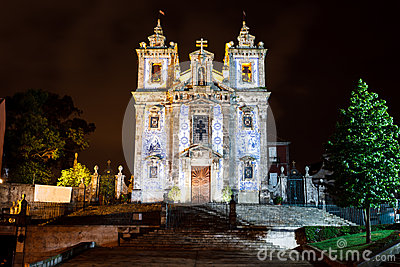 Night time, illuminated facade of Porto Portugal s tiled Romanesque Catholic Cathedral Editorial Photography
