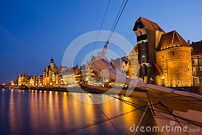Night view over the river Motlawa the Old Town with sailing ship