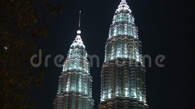 Night View Of Petronas Twin Towers, KL, Malaysia. Close-up low-angle tilting shot of the monumental, tall, Petronas Twin Towers, KL, Malaysia stock footage
