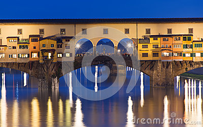 Night view of Ponte Vecchio over Arno River in Florence