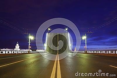 Night view of raised bridge in St.Petersburg