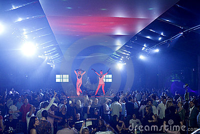 Nightclub scene with dancers and lights show Editorial Stock Image