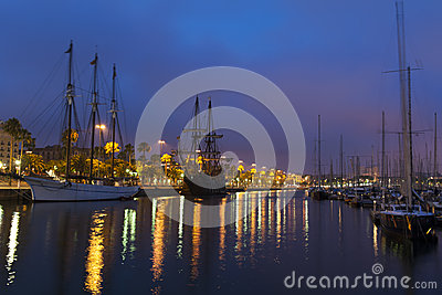 Nightscene with tall ships in harbour
