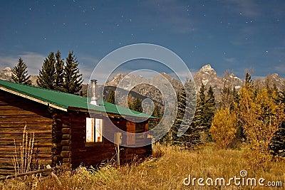 Nighttime log cabin