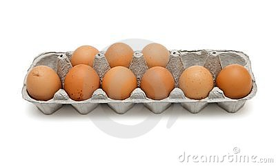 Nine brown eggs in box isolated