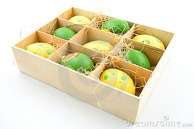 Nine painted easter eggs in a box