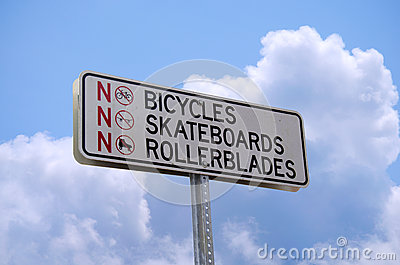 No bicycles skateboards or rollerblades sign
