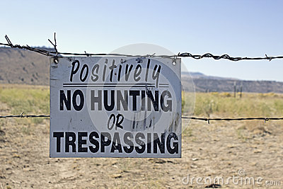 No Hunting Or Trespassing Sign on Barbed Wire