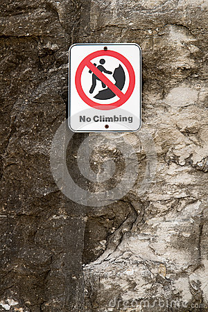 No Rock Climbing Danger Sign on Cliff
