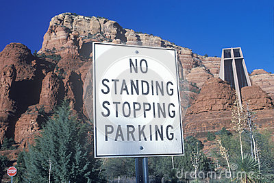 No standing stopping parking sign