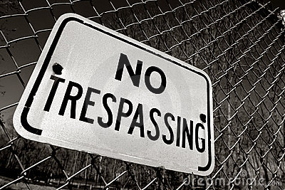 No Trespassing Warning Sign on Security Fence