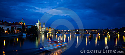 Nocturnal panoramic view of Charles Bridge Editorial Stock Image
