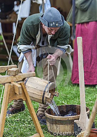 Medieval Man Pouring Water Editorial Photography