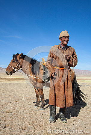 Free Nomad With His Horse Royalty Free Stock Photography - 30425837