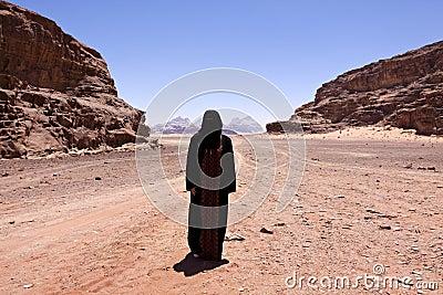 Nomadic woman with burka in wadi rum