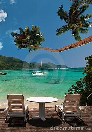 вал рая ладони стулов пляжа