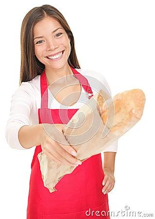 产生销售额妇女的面包职员