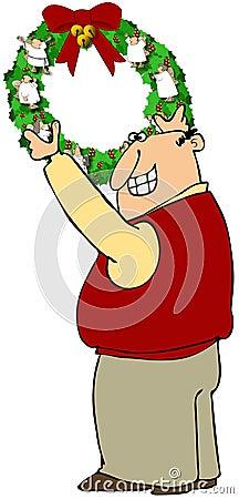 Άτομο που κρεμά ένα στεφάνι