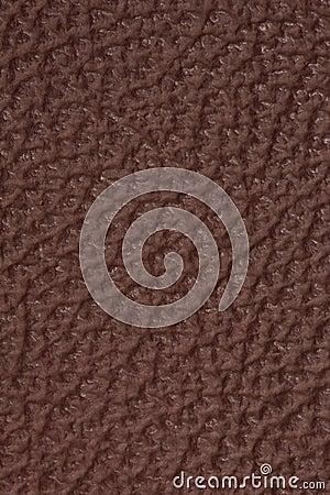 织地不很细棕色皮革背景