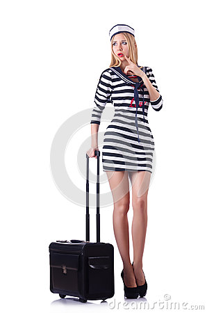 妇女带着手提箱的旅行乘务员