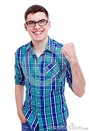 Счастливый парень с поднятым кулаком