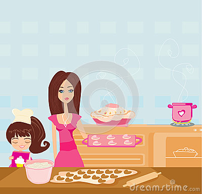 帮助她的母亲的愉快的女儿烹调在厨房里