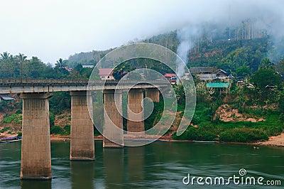 Nong Khiaw Bridge at misty morning