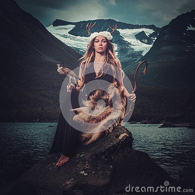 Free Nordic Goddess In Ritual Garment With Hawk Near Wild Mountain Lake In Innerdalen Valley. Stock Images - 75330394