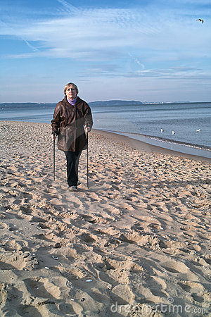 Nordic walker on beach