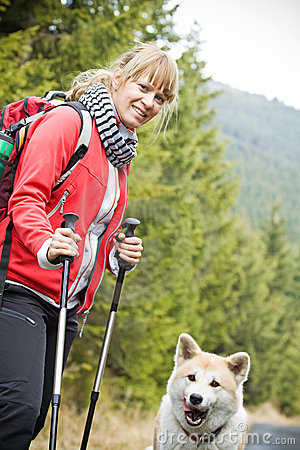 Nordic Walking with dog in mountains