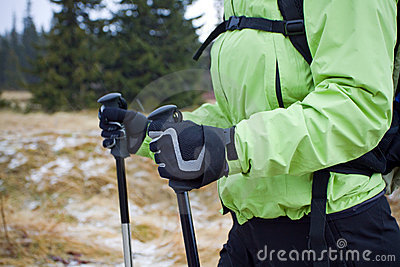 Nordic walking in mountains, hands and poles