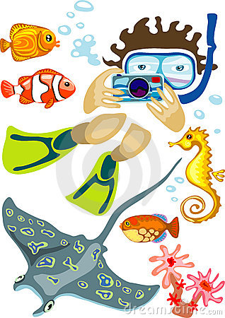 Norkeling man with photo camera and exotic fishes