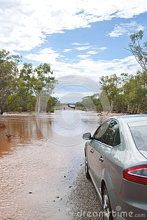Normal car waiting at flooded road