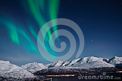 Northern lights above fjords, Norway
