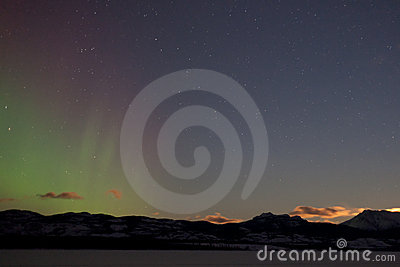 Northern lights (aurora borealis) and rising moon