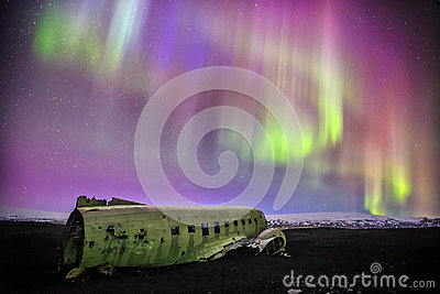 Northern lights over plane wreck in Vik, Iceland Stock Photo