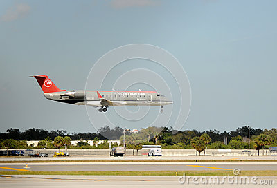 Northwest Airlines regional jet landing Editorial Stock Image