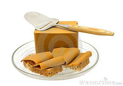 Norwegian brown cheese and cheese cutter