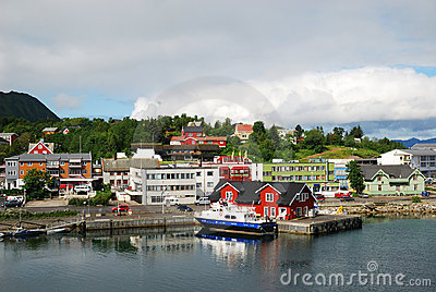 Norwegian town with small wharf by the fjord