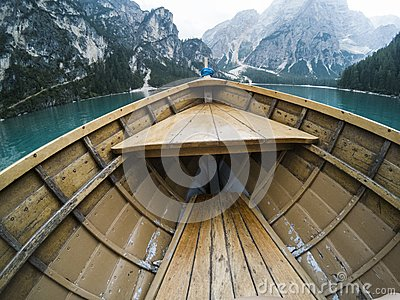 Nose of wooden boat at the alpine mountain lake. Lago di Braies, Dolomites Alps, Italy. Stock Photo