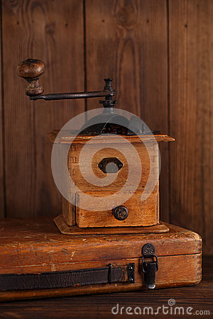 Free Nostalgic Coffee Grinder On Old Stool Royalty Free Stock Photos - 46843098