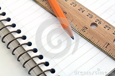 Note book with pencil and ruler