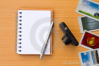 Note book , photo , pen and camera. On the floor o